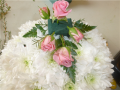 behind the backgarden funeral flowers Pink roses wreath