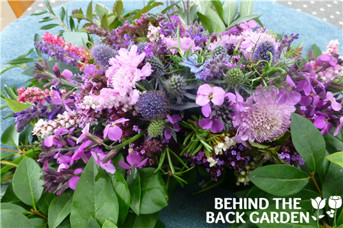 behind the backgarden funeral flowers wreath