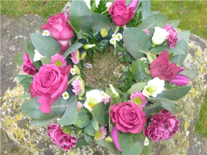behind the backgarden funeral flowers wreaths roses